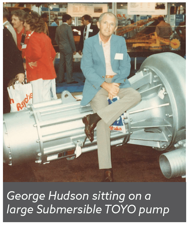 George Hudson sitting on a large Submersible TOYO pump
